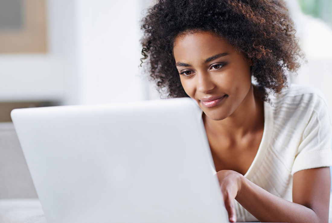Female on laptop, click to access patient portal